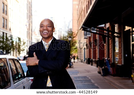 A happy business man, downtown in a city