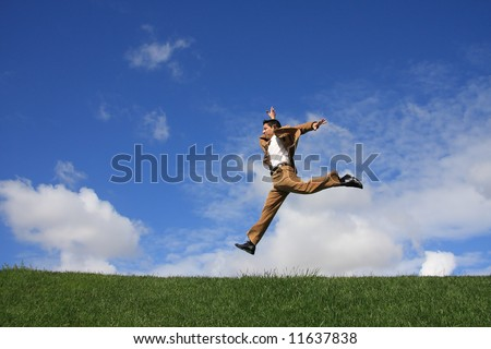 A happy business man jumping to the success - stock photo