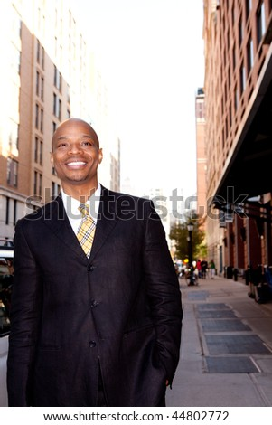 A happy business man on a street in a city