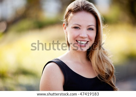 A happy business woman isolated against a difuse background - stock photo
