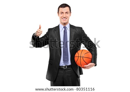 A happy businessman holding a basketball and giving thumb up isolated on white background - stock photo