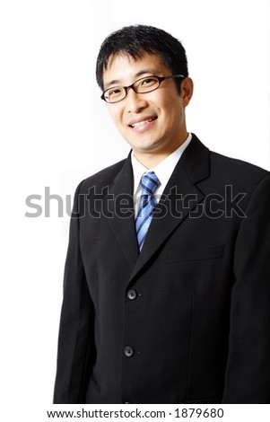 A happy businessman in isolated white - stock photo