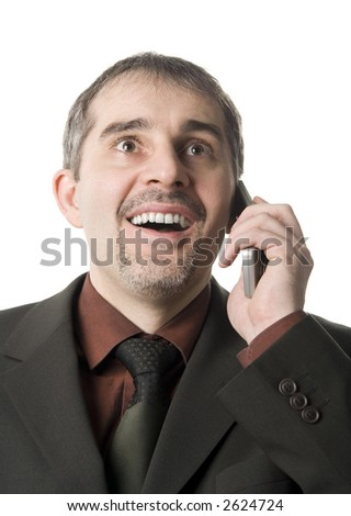 A happy businessman talking on the cellular phone