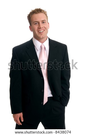 A happy businessman with his hand in his pocket - stock photo