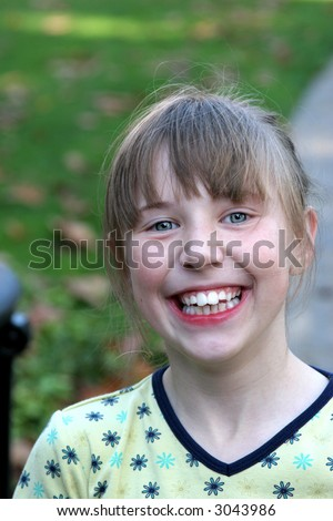 A happy child in need of braces - stock photo