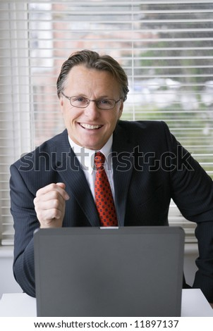 A happy confident man in suit. - stock photo