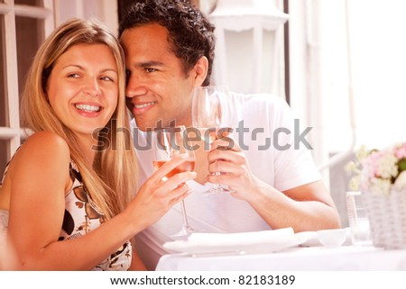A happy couple in a outdoor restaurant on a date - stock photo