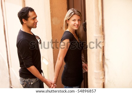 A happy couple in an outdoor European quaint street - stock photo
