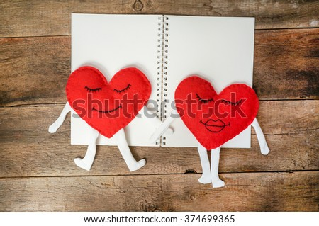 A happy couple in love with  smiles over wooden background. Valentines day background - stock photo