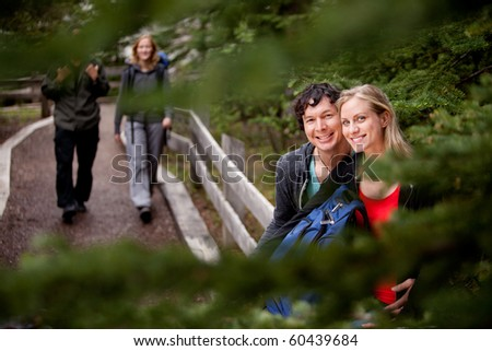 A happy couple on a forest trail - stock photo