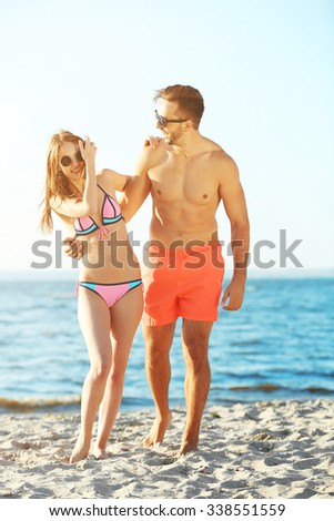A happy couple relaxing at the beach, outdoors