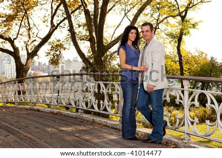 A happy couple relaxing in a park in New York - stock photo