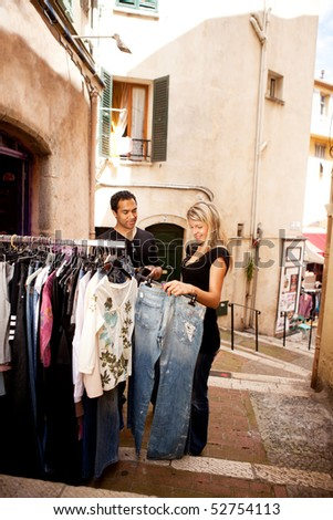 A happy couple shopping in a small street in europe - stock photo