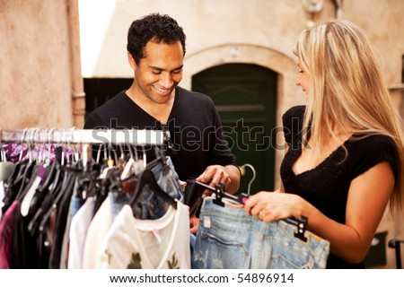 A happy couple shopping in a small street in France, Europe - stock photo