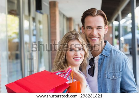 A happy couple with shopping bags at the mall