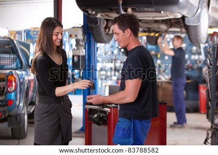 A happy customer delivering a car to a auto repair shop - stock photo