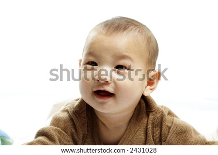 A happy cute baby boy laughing in joy and happiness - stock photo