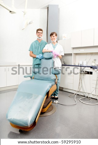 A happy dental team, dentist and assistant in a dental clinic - stock photo