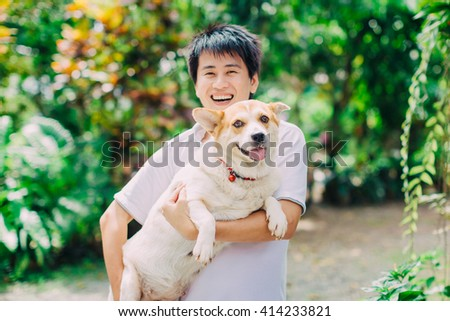A happy dog and her owner : Soft and selective focus picture style.