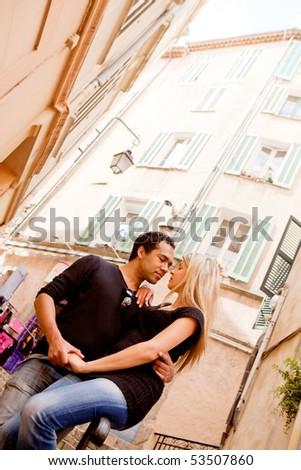 A happy european couple in a small quaint street - stock photo