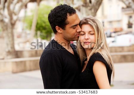 A happy european couple in an urban setting - stock photo