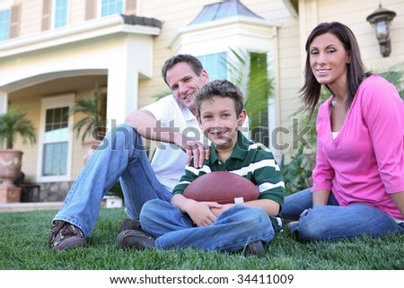 A happy family having fun at  home (Focus on Boy) - stock photo