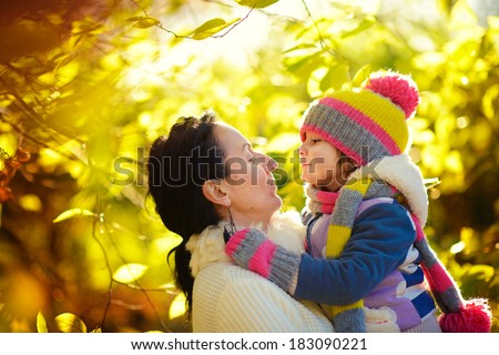 A happy family in a park on a sunny autumn day - stock photo