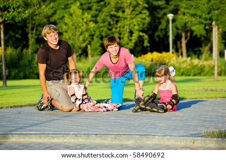 A happy family in roller skates - stock photo