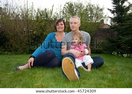 A happy family in the garden. - stock photo
