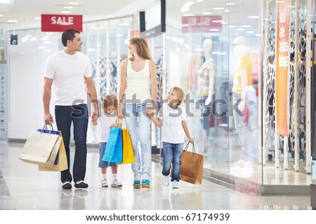 A happy family is shopping in a store - stock photo