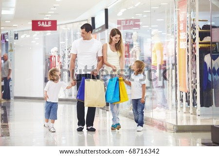 A happy family makes purchases in the store - stock photo