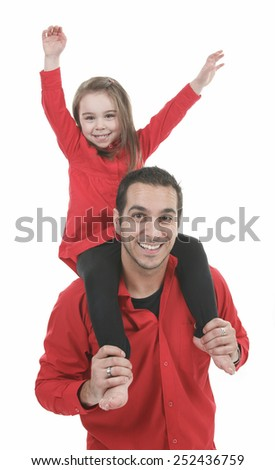 a happy family member. A father with daughter on his shoulder. - stock photo