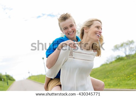A happy family mother and herson spending time outdoor on a summer day - stock photo