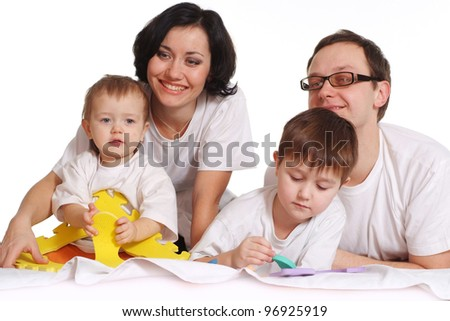 A happy family of four on a bed on a isolate background