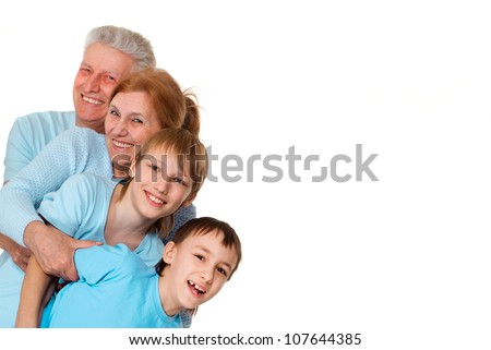 A happy family of four on a light background - stock photo