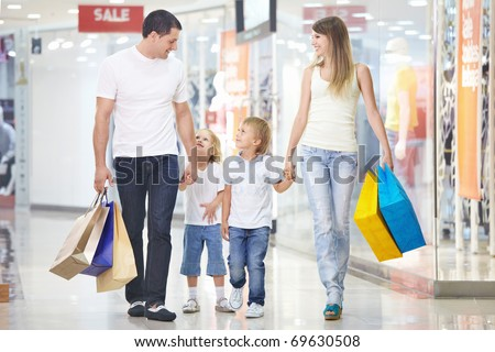 A happy family on shopping in the store - stock photo