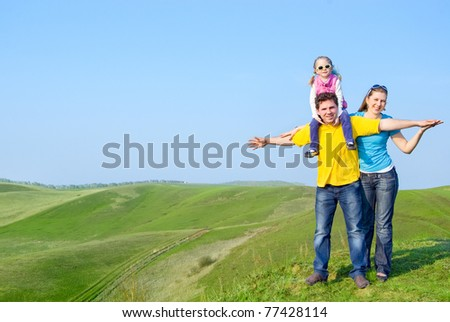 A happy family on the hill - stock photo