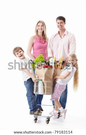 A happy family with a cart with food on a white background