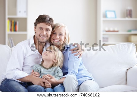 A happy family with a child - stock photo