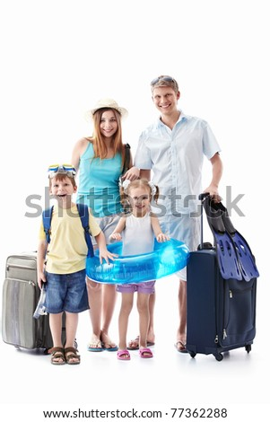A happy family with children and suitcases isolated - stock photo
