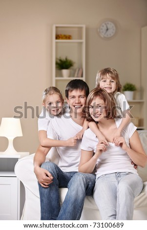 A happy family with children at home - stock photo