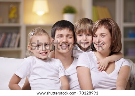 A happy family with children at home in the evening - stock photo