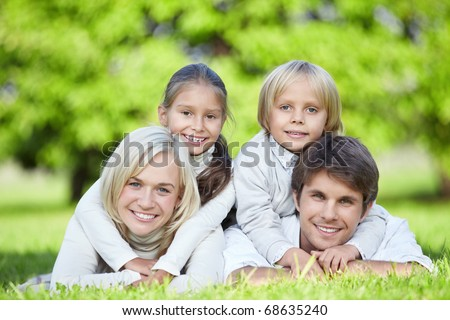 A happy family with children outdoors - stock photo