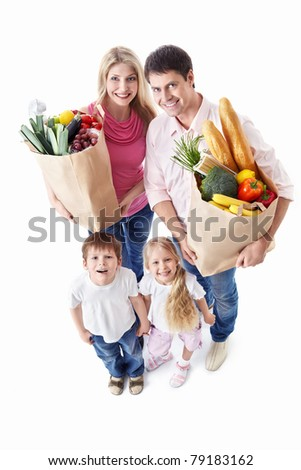 A happy family with their purchases on a white background - stock photo