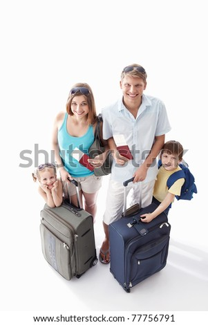 A happy family with their suitcases and passports to leave on a white background - stock photo