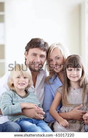 A happy family with two children - stock photo