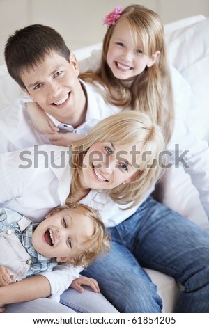 A happy family with two children on the couch - stock photo