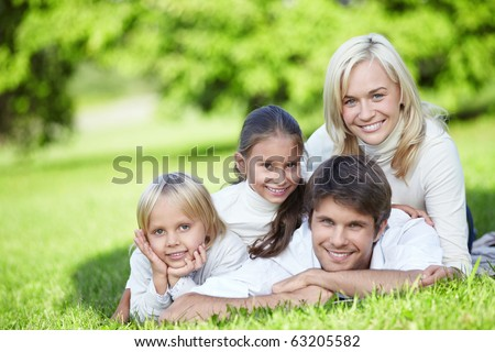 A happy family with two children outdoors