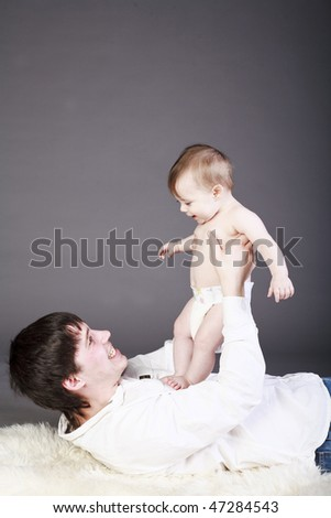 A happy father with his baby boy. - stock photo