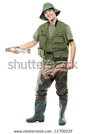 A happy fisherman holding a fish in his hand isolated on white background